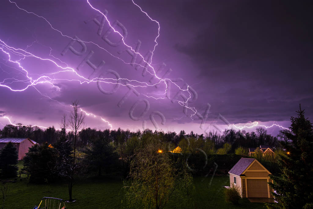 Purple lightning in night sky