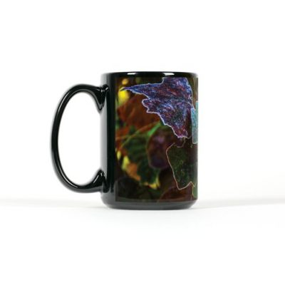 Left side view of black mug with dark autum leavs with frost coateded edges