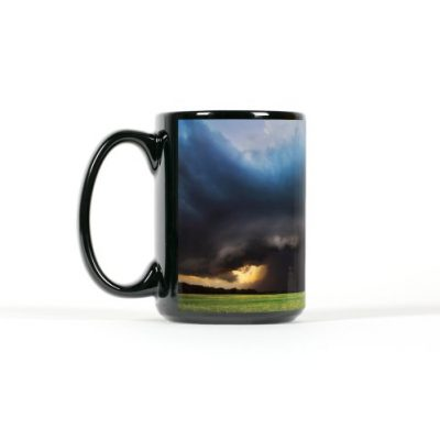 Left side view of black mug with a supercell over a farmfield